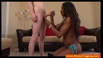 Ebony babe on knees jerks white dick