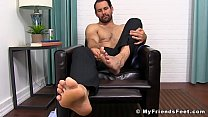 Handsome businessman presenting us with his gorgeous feet