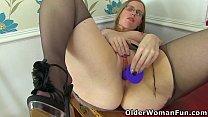 British milf Sammie gets busy with a dildo