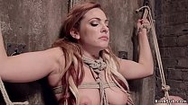 Busty slave hanged on the wall in bdsm