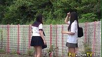 Asian teenagers outdoors urinate صورة