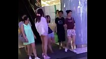Asian Girl in China Taking out Tampon in Public...