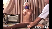 Older slut gets teased while being tied to armchair