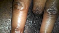 Ebony milf fingering her wet pussy