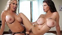 Busty lesbian Brandi Love scissoring and using huge dildo with her busty friend