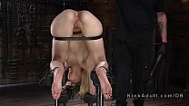 Image: Blonde slave in device bondage clit clamped