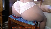 Pear shaped hottie on a chair