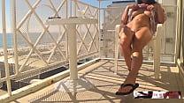 hidden camera caught a sexy girl masturate on hotel balcony near a crowd beach.