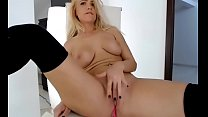 blond hot camgirl fingers her pussy in a sexshow