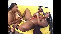 BBW ebony MILF fucks another BBW with a dildo at home