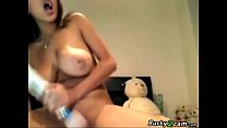 Busty playing with her tits and dildo in her bedroom