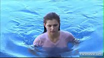 Sexy teen Fiona wearing a wet t-shirt and playing with her perky nipples thumbnail