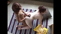 Chubby whore and her girlfriend fucking with strap-on on the floor in living room