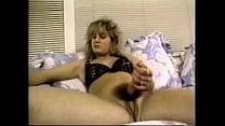 Image: Blond buxom hermaphrodite jerks off as she fucks herself with huge dildo.