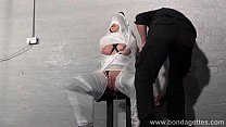 Blonde damsel Taylor Hearts plastic wrapped bondage and stool restrained submiss