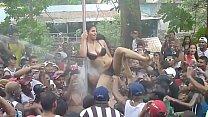 Women undress at Panamanian carnival - 2014