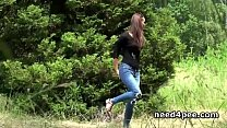 Skinny teen pissing behind a wall outdoor