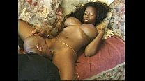 Big tits ebony in action on the bed