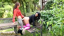 Girls in garden enjoy sex and piss Preview