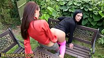 Girls in garden enjoy sex and piss