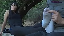 Beautiful milf has her feet tickled outdoor