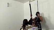 Rubber-nurse anally fists her male slave Vorschaubild
