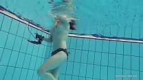 Redheaded Katrin is stripping underwater Image