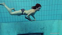 Redheaded Katrin is stripping underwater thumbnail