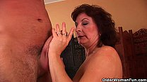 Grandma with big tits and hairy pussy gets facial Image