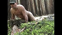 Humping naked a fallen tree trunk in the woods