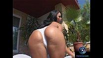 Enchanting Christina Bella sits on the sofa to use her long dildo