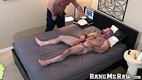 Inked hunk sucks huge dick before it barebacks him doggy