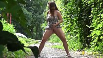 Pee Standing - Curvy brunette relieves herself in the park