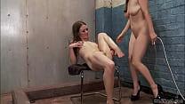 Redhead gives enema to slim lesbian