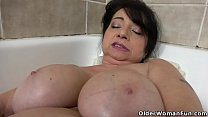 Big titted granny Deborah dildos her old pussy in bathtub