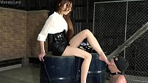 Japanese Femdom Risa plunges her foot deep into the slave's throat
