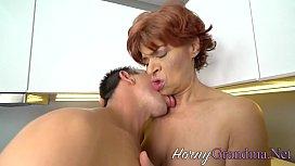 Mature redheaded slut blows cock
