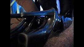 Brunette in black latex and high heels