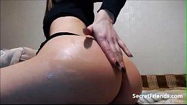 Rubbing oil on perfect bubble butt