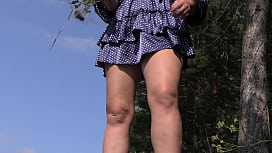 Under the skirt without panties. Voyeur peeks under the dress outdoors and admires hairy pussy and juicy PAWG. Amateur fetish.