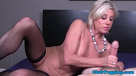 Busty mature amateur wanking penis