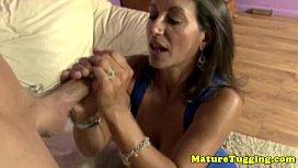 Big titted brunette mature jerks cock