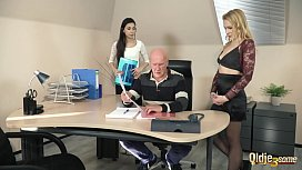 Old manager at the office fucks his two beautiful assistants right in his office he puts his cock inside their pussies fuck them hard and cums right in their mouths so he can watch them lick the cumshot and spit it
