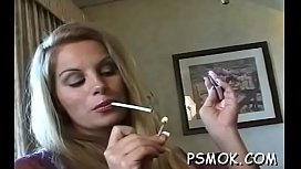 Mature bitch blows a guy while smokin'_ a cigarette