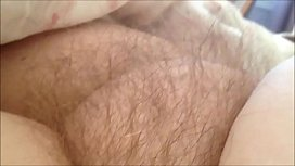 Rubbing her hairy MILF pussy