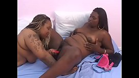 Young ebony Diamond Dior sucks a dildo while her lesbian lover Black Cherry fucks her with a strap on