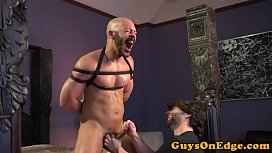 Restrained sub jerked until cumshot by dom