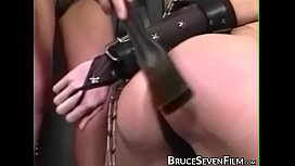 Babe in chains paddled into submission by rough dyke