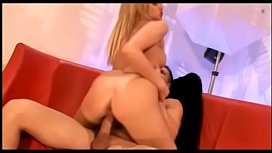 Lusty blond nympho with round ass rides massive cock on red couch