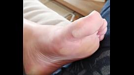 Rubbing her foot